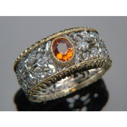 Picture Beautiful ring - spessartine gold and diamonds by Pellini