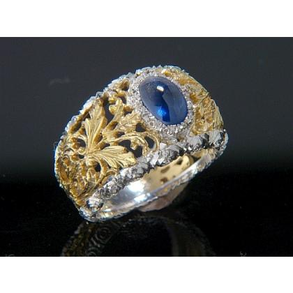 Picture Gold ring with a sapphire