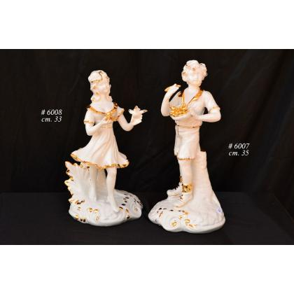Picture Ceramic figurines of boy and girl