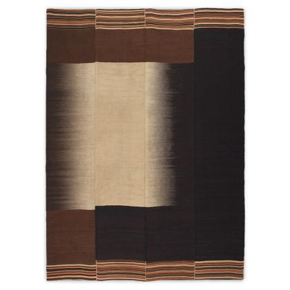 Picture Handmade woollen carpet with a predominance of brown and black